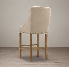 RH's Nailhead Fabric Stool:Handcrafted with an oak frame and solid oak legs, our stool features plush padding and crisply tailored upholstery. A weathered finish and antiqued brass nailheads bring a touch of rustic flair.