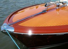 Google Image Result for http://www.seabuddyonboats.com/wp-content/uploads/2012/04/Riva-Super-Ariston-classic-wood-boat-bow.jpg