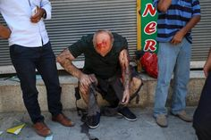 A wounded man sits on a step following an explosion in Suruc, in the southeastern Sanliurfa province, Turkey, July 20, 2015. REUTERS/Ozcan Soysal/Depo Photos
