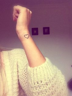 Small heart tattoo on the wrist: subtle but sweet.