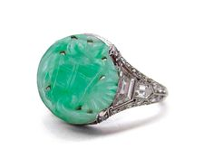 Edwardian, Belle Epoque, Platinum and Carved Burma Jade Cabochon, Flanked with Baguette Diamonds