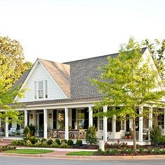 Farmhouse Revival, Plan #1821 | Our 2012 Idea House, this plan is all about casual comfort. Exterior detailing and a wraparound porch add a classic, Southern feel. | SouthernLiving.com