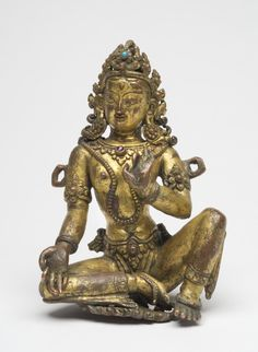"""Nepal made similar works for both Hindus & Buddhists Malla period fashion and jewels on unknown Hindu or Buddhist goddess. Gilded copper & gems. 4 ¾"""" late 15th-16th C."""