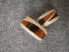 These rings are made of solid surfacing, cherry, and walnut. The picture shows 2 different views of the some style ring. $100 each