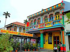 In the background, you can see what I like to call the Singaporean Willy Wonka's house (used to belong to a candymaker). Foreground house is now a store. A house in Little India by linkway88, via Flickr