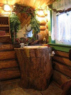 Charming log cabin bathroom with vanity made from a log