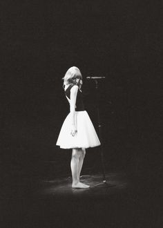 I just love this. The way She's not wearing heels, she's wearing a simple dress. And she's being who she is.