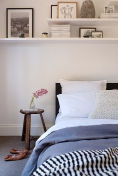 Get a simple side stool or similar with side lamp for the guest room. Each side of bed doesn't need to be matching as mis matching looks stylish