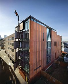 Olson Kundig Architects: Seattle live/work loft project includes a seven-story building featuring ground-level retail space, second-floor parking, and five stacked residential units.