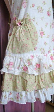 I like the color combo and the pocket with the ruffles. Very feminine. If you have to be in the kitchen, why not look pretty??