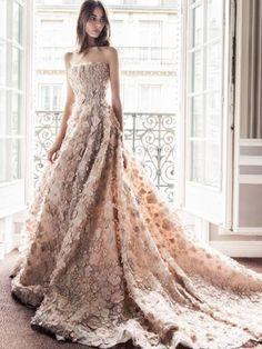Elegant strapless beige floral applique wedding dress; Featured Dress: Paolo Sebastian