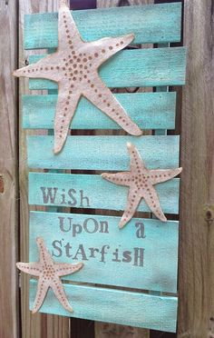 """This artistic, fun """"Wish Upon a Starfish"""" rustic pallet by Beth celebrates Earth Day! She used Walnut Hollow wood pallet and Kunin Group felt."""