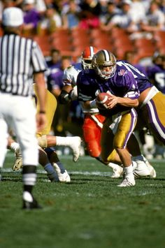 Mark Brunell of the Washington Huskies runs the ball against the Florida Gators during the 1989 Freedom Bowl at Anaheim Stadium in December 30 1989...