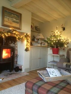 Note the wood stove insert into a chimney/hearth piece with a mantle. Quite lovely Cottage Lounge, Cottage Living Rooms, Cottage Interiors, Tiny Living, Christmas Living Rooms, Cottage Christmas, Christmas Room, Christmas Fireplace, Simple Christmas