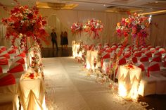 Bright hotel ceremony design with touches of orange and yellow roses. #flowers #wedding #ceremony
