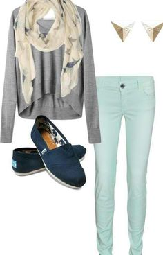 Cute outfit to wear for a date or school or to go out anywhere. Gray knitted high and low long sleeve shirt or sweater with ivory scarf. Light blue jeans with navy blue toms. Maybe different earrings though...