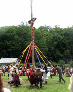 Renaissance Faire fabric braid on a wood pole (great party idea maybe for wedding *) weave in and out among people or friends to make braid.  So much Fun! Add music and you have a even more grand party.