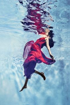 An underwater shoot of amazing designer gowns by Gucci, Chloe, Roberto Cavalli and more...