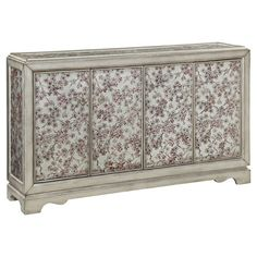 Lend a touch of garden-chic charm to your dining room or parlor with this eye-catching sideboard, showcasing cherry blossom-inspired motif and burnished silv...