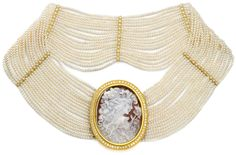 A custom-carved cameo made from Italian coral sits at the center of this one-of-a-kind choker. This Italian Lady is set inside a 22K gold, hand-granulated bezel with diamonds all around. The cameo can be removed from the 18 strands of fresh water pearls. The 22K gold and diamond spacers position the pearls to display the cameo elegantly.  www.Zeira.com www.facebook.com/ZeiraJewlery