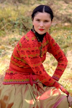 Oleana Pullover Design 169-E, Hat Design 120-E, Scarf Design 174-E, Wristlets Design 171-E, Fingerless Gloves Design 119-E Silk Brocade Belt Design 78-E Silk Skirt Design 75-G Norwegian Sweaters