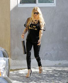 Fergie in slim pants and ankle strap high heels