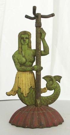 Antique mermaid lawn sprinkler
