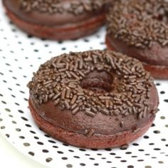Recipe for whole wheat donuts, filled with dark chocolate chips and topped with a creamy chocolate ganache and chocolate sprinkles.