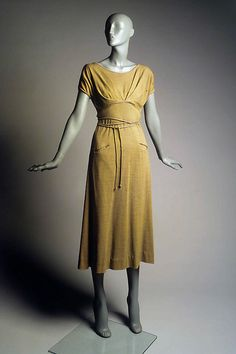 Dress Claire McCardell (American, 1905–1958) Manufacturer: Townley Frocks (American) Date: ca. 1952 Culture: American Medium: Wool Credit Line: Brooklyn Museum Costume Collection at The Metropolitan Museum of Art, Gift of the Brooklyn Museum, 2009; Gift of Mildred Morton, 1961 Accession Number: 2009.300.7184