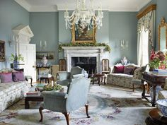 """Inside the cool blue drawing room at Amanda and Stephen Clark's country home in Wiltshire. The custom sofa in a Colony fabric """"was inspired… Georgian Interiors, Georgian Homes, French Interiors, Vintage Interiors, Rugs In Living Room, Living Room Decor, Drawing Room Interior, Drawing Rooms, Blue Drawings"""