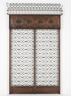 Dankmar Adler (1844-1900) & Louis Sullivan (1856-1924) - Elevator Enclosure Panels & Surround. Cast & Wrought-Iron with Copper-Plated Kick-Plates. Designed for the Chicago Stock Exchange Building, Chicago, Illinois. Manufactured by Winslow Brothers Company. Circa 1893.