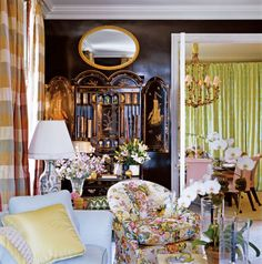 A 19th-century bureau-bookcase with chinoiserie details adds ballast and height to a Manhattan living room.