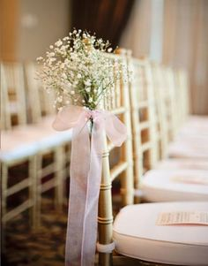 Stylish Indoor Aisle Decorations Baby breath chairs decorations with an orange bow