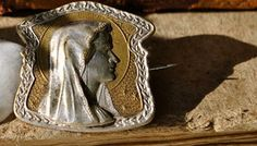 """An unusual Virgin Mary brooch from the Art Nouveau period 1890 - 1910 and has exceptional detailing.  It measures a little more than 1"""" x 1"""" (2.5 cm). It has a 'c' clip closure that is perfect."""