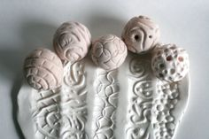 These sculpture balls are very fun to use. You simply roll them along the clay or other moldable material to produce a pattern or texture that is a