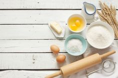baking a cake from above rolling pin eggs flour