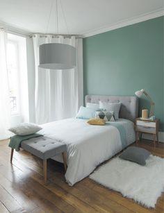 Nordischer Stil mit einem Bett mit Kuschelfaktor.