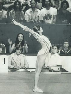 Nadia Comaneci from Romania - 1st gymnast to score a perfect 10 at the Olympics July 18, 1976