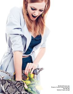 From our editorial: SIXTIES. Photo: Angela Improta. Fashion: Sabrina Mellace. Burberry Prorsum coat, Ermanno Scervino bustier and pants, Miu Miu bag, Kettlebell Jewels earrings. @Burberry #prorsum #coat @Ermanno Scervino #bustier #pants #miumiu #bag @Vallina Kettlebell Jewels Italy #earrings