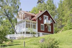 Swedish red house with multi level white porches. Swedish Cottage, Red Cottage, Cottage Homes, Red Houses, Yellow Houses, Yellow House Exterior, Sweden House, Scandinavian Home, Traditional House