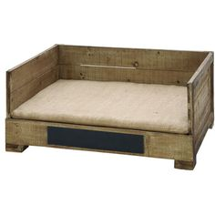 Wood pet bed with a cushion and a vintage-style crate design.     Product: Pet bed    Construction Material: Wood and ...