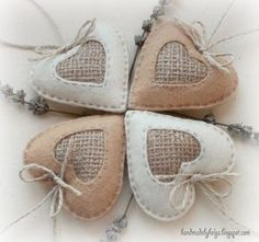 I love the rustic style. So I decided to experiment and make rustic hearts. I used felt, burlap and natural jute thread. Here is the result...