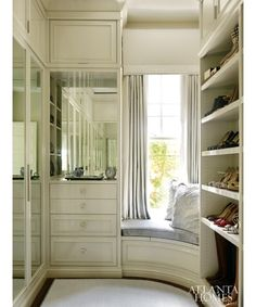 Luxurious Walk-In Master Closet with a Built-In Window Seat