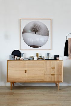 Beautiful oak sideboard with large photography artwork hanging above. Want. It. ALL
