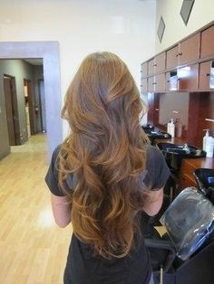 Waist-Length Warm-Light-Brown Wavy Hair with Lots of Layers and Movement