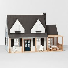 As part of the new Hearth & Hand with Magnolia 2018 holiday collection at Target, you can buy a Joanna Gaines-approved farmhouse style doll house and accessories—plus, a totally chic play kitchen complete with adorable wooden food. Modern Farmhouse, Farmhouse Style, Farmhouse Design, Farmhouse Decor, Wooden Dollhouse, Diy Dollhouse, Dollhouse Design, Wooden Dolls, Herd