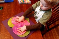 Kids painting hearts separately to make one piece of art for Valentine's Day