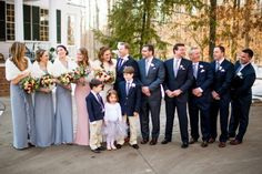 pastel bridesmaid dresses, navy groomsmen suits, winter wedding bridal party.  from winter vintage glamour wedding at Stevenson Ridge with Stephanie Messick Photography