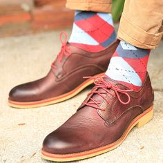 Statement Sockwear mod argyle design featuring the April Sock Color of the Month: Apple Red. Try some brown Wolverine oxfords with red laces for some additional style.