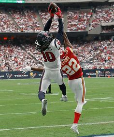 Wide receiver DeAndre Hopkins of the Houston Texans makes a touchdown catch against Marcus Peters of the Kansas City Chiefs.